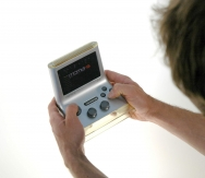 Holding_A_MOMA_Mobile_Gaming_Console